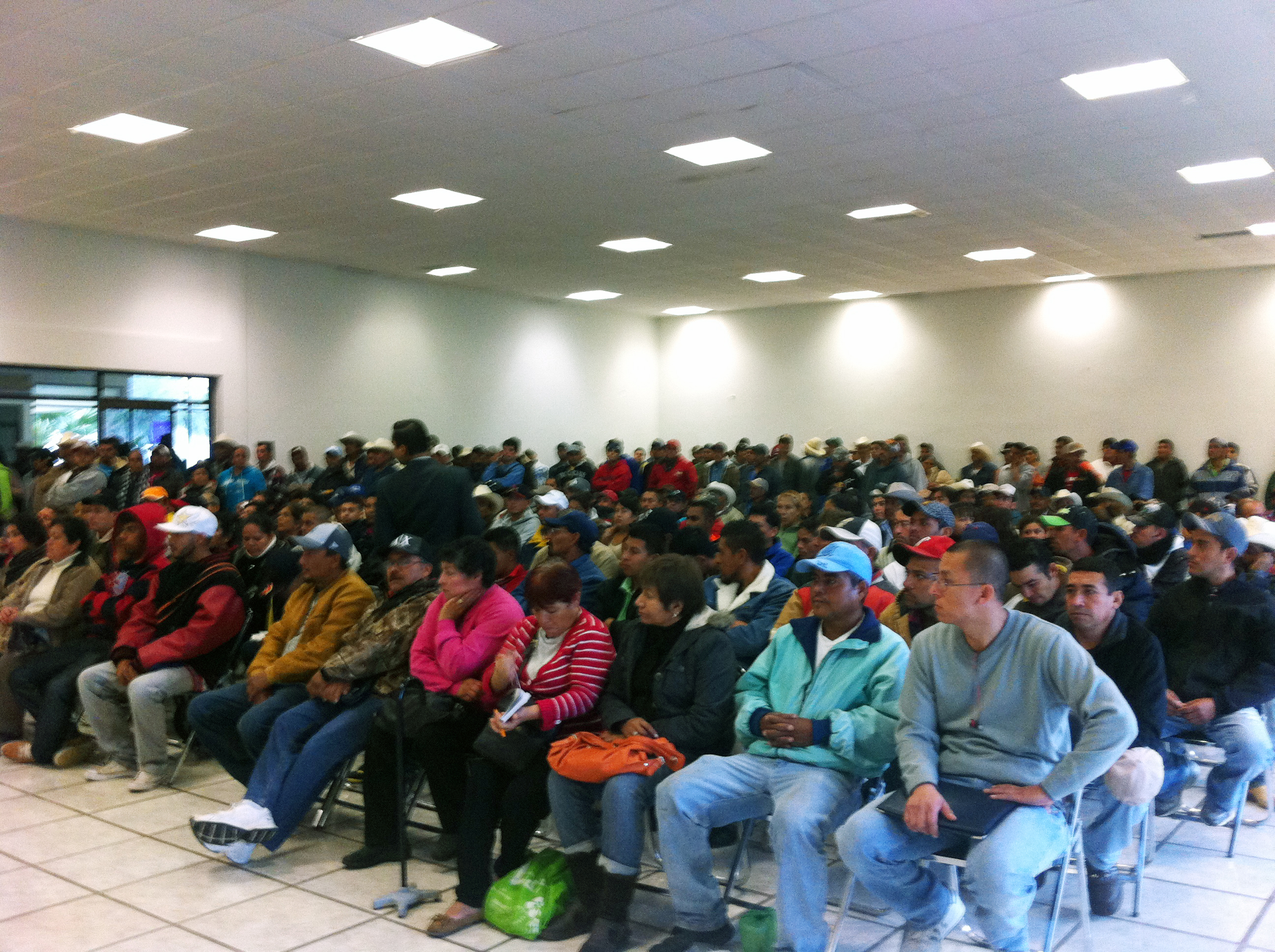 Participants listen to an educational workshop in San Luis Potosi